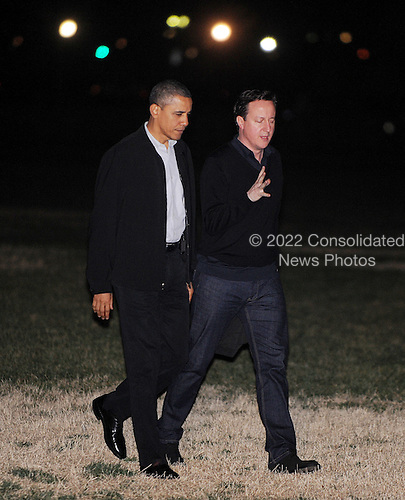 United States President Barack Obama and Prime Minister David Cameron of Great Britain return to the White House on March 13, 2012 in Washington, D.C. the President and Prime Minister attended a first round game during the NCAA Division I Men's Basketball Championship First Four at the University of Dayton Arena. .Credit: Olivier Douliery / Pool via CNP