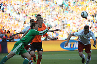 Danish goalkeeper Thomas Sorensen punches the ball to safety off a cross intended for Holland's Dirk Kuyt.Holland defeated Denmark, 2-0, June 14th, at Soccer City in the opening match of Group E of the 2010 FIFA World Cup.