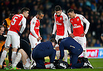 Arsenal players check on Per Mertesacker of Arsenal following his head injury - English FA Cup - Hull City vs Arsenal - The KC Stadium - Hull - England - 8th March 2016 - Picture Simon Bellis/Sportimage