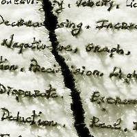 List of words on paper, ripped in half