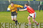 Listowel Emmets Brendan Guiney brushes off the close attention of Brosna's  Peter Curtin.