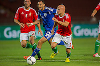 Hungary's Norbert Meszaros (L) and Hungary's Jozsef Varga (R) fight for the ball with Israel's Omer Damari (C) during a friendly football match Hungary playing against Israel in Budapest, Hungary on August 15, 2012. ATTILA VOLGYI