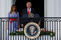 U.S. President Donald Trump and First Lady Melania Trump attend a picnic for military families in Washington, D.C., U.S., on Wednesday, July 4, 2018. Dozens of retired military and national security officers joined the NAACP and the American Medical Association in urging a federal appeals court to uphold a court order blocking Trump's ban on transgender people serving in the military. <br /> CAP/MPI/RS<br /> &copy;RS/MPI/Capital Pictures