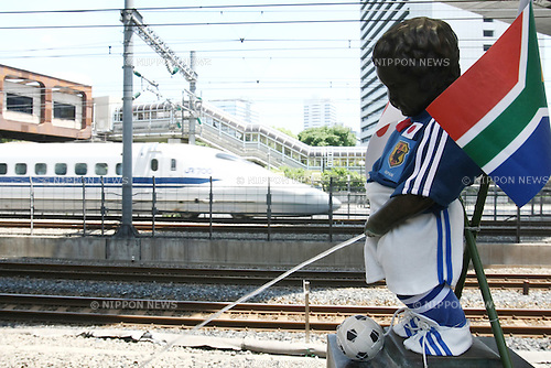 """June 1, 2010 - Tokyo, Japan - Peeing Boy """"Shoben Kozo"""" wearing Japan National Soccer Team suit is pictured at Hamamatsucho station in Tokyo, Japan, on June 1, 2010. A volunteer group makes clothes and dresses up in seasonal outfits the bronze statue installed in the station since 1968. The Japan national football team, nicknamed Samurai Blue, will start 2010 FIFA World Cup South Africa tournament against Cameroon, on June 14."""