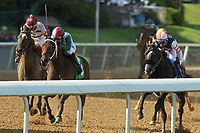 HOT SPRINGS, AR - APRIL 15: Inside Straight #5 (center), with jockey Geovanni Franco aboard holding off Domain's Rap #2 (left), Midnight Storm #3 (right), before crossing the finish line in the Oaklawn Handicap at Oaklawn Park on April 15, 2017 in Hot Springs, Arkansas. (Photo by Justin Manning/Eclipse Sportswire/Getty Images)