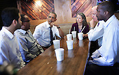 United States President Barack Obama (3rd L) and Vice President Joseph Biden (5th L) meet with local workers (L-R) Aidin Sarabi, Abdullahi Mohamed, Meredith Upchurch, and Antonio Byrd at the Dupont Circle location of restaurant chain Shake Shack May 16, 2014 in Washington, DC. President Obama and Vice President Biden met with the workers to discuss increasing investment in re-building America's infrastructure for the future. <br /> Credit: Alex Wong / Pool via CNP
