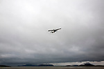 Flybe plane taking off, Isle of Barra airport, Barra, Outer Hebrides, Scotland, UK