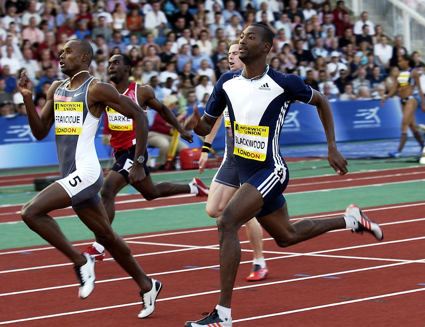Photo. Henry Browne..Norwich Union London Grand Prix Athletics at Crystal Palace. 30/07/2004..Mens 400m..Alleyne Francique leads the race from Michael Blackwood.