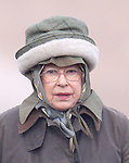 ©Albanpix.com-Picture by Alban Donohoe.The Queen wears  wool lines hat over the top of her hood and head Scalf as she braves the cold snap on a Pheasant shoot on the Sandringham est. Norfolk as the temperature drops to -5 degrees.10/01/09