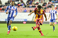 Substitute Tyrell Robinson of Bradford City scores a last minute winner during the Sky Bet League 1 match between Wigan Athletic and Bradford City at the DW Stadium, Wigan, England on 18 November 2017. Photo by Thomas Gadd.