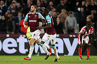 Andy Carroll of West Ham United celebrates scoring the opening Hammers goal during West Ham United vs Stoke City, Premier League Football at The London Stadium on 16th April 2018