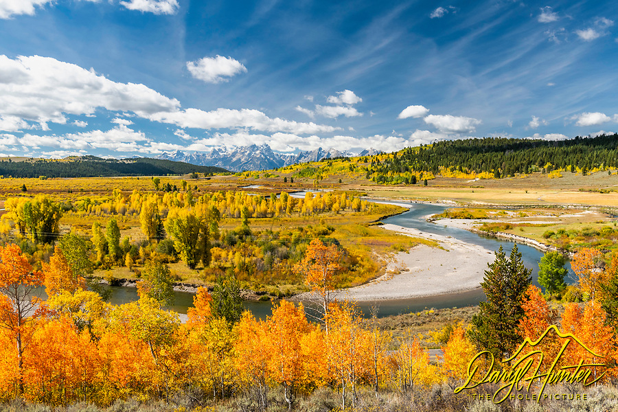 Autumn at the Buffalo Fork of the Snake River, the Grand Tetons rise beyond.