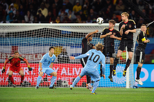 11 07 2010  Simon Free kick from Diego Forlan Uru Hi v left Hans Joerg Butt ger Goalkeeper Luis Suarez Uru Cacau ger Thomas Mueller ger Per Mertesacker ger Bastian Schweinsteiger ger Free kick wall Uruguay Uru Germany ger . The 2010 FIFA World Cup, 3rd place playoff Uruguay v Germany. Played at the Nelson Mandela Bay Stadium, Port Elizabeth, South Africa.