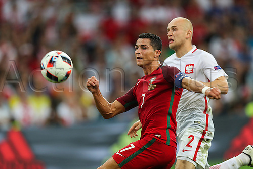 30.06.2016. Marseille, France. UEFA EURO 2016 quarter final match between Poland and Portugal at the Stade Velodrome in Marseille, France, 30 June 2016.   Cristiano Ronaldo (POR), Michal Pazdan (POL)
