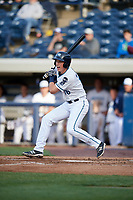 West Michigan Whitecaps designated hitter Cole Bauml (16) follows through on a swing during a game against the Clinton LumberKings on May 3, 2017 at Fifth Third Ballpark in Comstock Park, Michigan.  West Michigan defeated Clinton 3-2.  (Mike Janes/Four Seam Images)