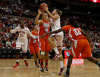 Ohio State Buckeyes guard Amy Scullion (25) drives by Bowling Green Falcons forward Jill Stein (40) and Bowling Green Falcons forward Alexis Rogers (32) in the first half at Value City Arena in Columbus Nov. 24, 2013.(Dispatch photo by Eric ALbrecht)