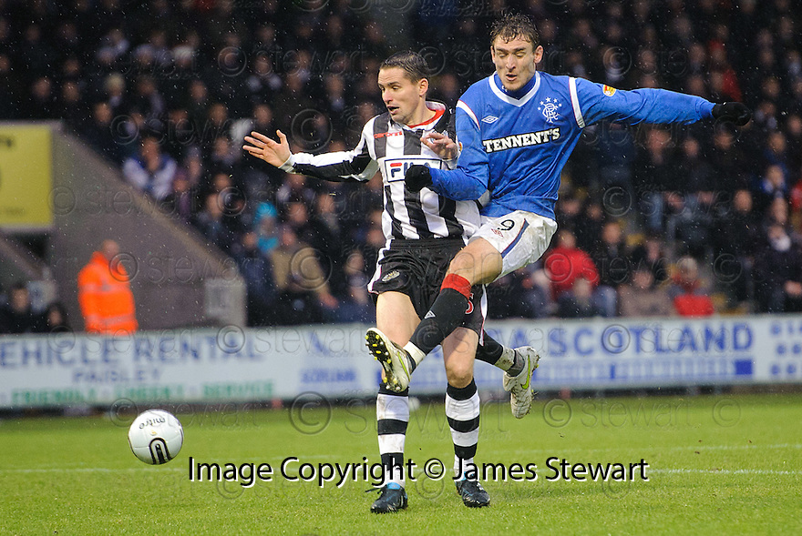 RANGERS' NIKICA JELAVIC SHOOTS AS ST MIRREN'S LEE MAIR CHALLENGES