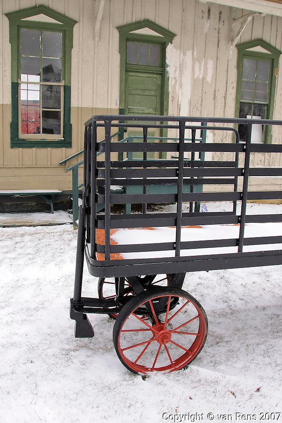 Classic 19th Century railroad station with Luggage cart carrier in winter scene