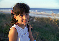 Portrait of a young girl at the beach.