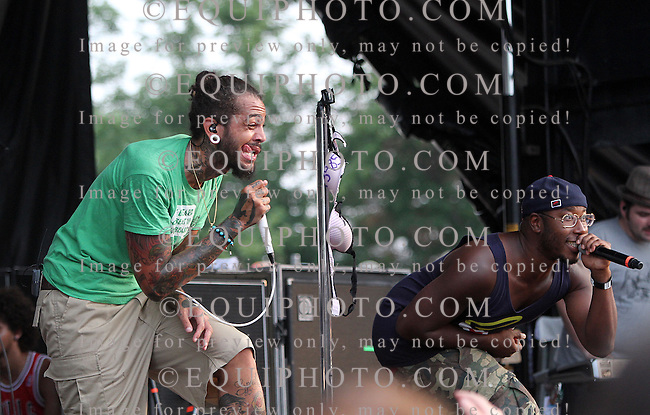 Gym Class Heroes perform at the Warped Tour at Monmouth Park Racetrack in Oceanport, New Jersey on Sunday July 24, 2011.  Performing were Travis McCoy, Matt McGinley and band.  Photo By Ryan Denver