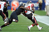 24 September 2011:  FIU safety Jonathan Cyprien (7) tackles ULL running back Aaron Spikes (20) in the first quarter as the University of Louisiana-Lafayette Ragin Cajuns defeated the FIU Golden Panthers, 36-31, at FIU Stadium in Miami, Florida.