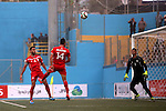 Palestinian players vies for the ball with UAE players during their 2018 FIFA World Cup qualifying football match between Palestine and UAE, at the Faisal al-Husseini Stadium, on September 8, 2015 in the West Bank town of Al-Ram. Photo by Shadi Hatem
