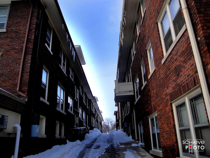Alleyway between apartment buildings.