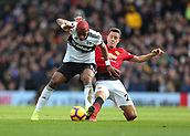 9th February 2019, Craven Cottage, London, England; EPL Premier League football, Fulham versus Manchester United; Ander Herrera of Manchester United tackles Ryan Babel of Fulham