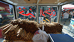 Bread sticks on sale in a cart in the market in the Al-Shalti refugee camp in Gaza. Residents of the Palestinian territory are still reeling from the death and destruction of the 2014 war with Israel, and the continuing siege of the seaside territory by the Israeli military.