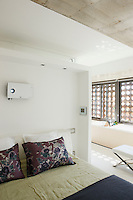 A video projector in the bedrooom is situated above the bed and behind the partition wall is the open-plan bathroom