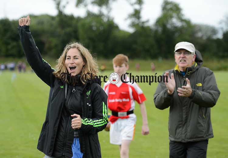 Killaloe's mentors Nicola Wood and Noel Coleman cheers on her team during their U-14 Tag Rugby game against Drangan/Clooneen at the Munster Community Games 2016 provincial finals in UL campus. Photograph by John Kelly.