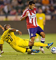 Columbus Crew forward Emilio Renteria (20) attempts to tackle Chivas USA midfielder Ante Jazic (6). CD Chivas USA defeated the Columbus Crew 3-1 at Home Depot Center stadium in Carson, California on Saturday July 31, 2010.
