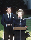 Prime Minister Margaret Thatcher of the United Kingdom, right, makes remarks as United States President Ronald Reagan looks on following their meeting at the White House in Washington, D.C. on Wednesday, June 23, 1982.  Thatcher died from a stroke at 87 on Monday, April 8, 2013..Credit: Howard L. Sachs - CNP
