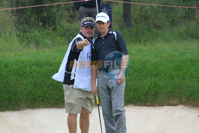 Peter Lawrie (IRL) and caddy Brian Martin in action on the 17th green during Day 3 of the Open de Espana at Real Club De Golf El Prat, Terrasa, Barcelona, 7th May 2011. (Photo Eoin Clarke/Golffile 2011)