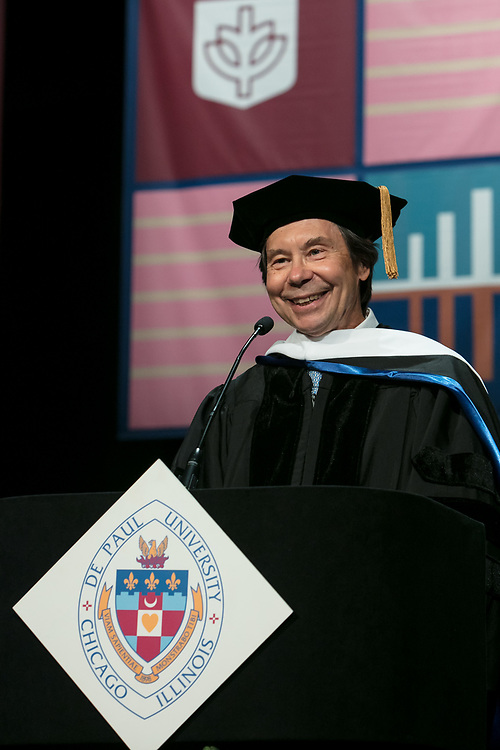 Stuart Dybek, poet and fiction writer, addresses the graduating class and receives an honorary degree Saturday, June 10, 2017, during the DePaul University School for New Learning commencement ceremony at the Rosemont Theatre in Rosemont, IL. (DePaul University/Jeff Carrion)