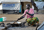 A woman cooks in the Yusuf Batil refugee camp in South Sudan's Upper Nile State. More than 110,000 refugees were living in four camps in Maban County in October 2012, but officials expected more would arrive once the rainy season ended and people could cross rivers that block the routes from Sudan's Blue Nile area, where Sudanese military has been bombing civilian populations as part of its response to a local insurgency. Conditions in the camps are often grim, with outbreaks of diseases such as Hepatitis E.
