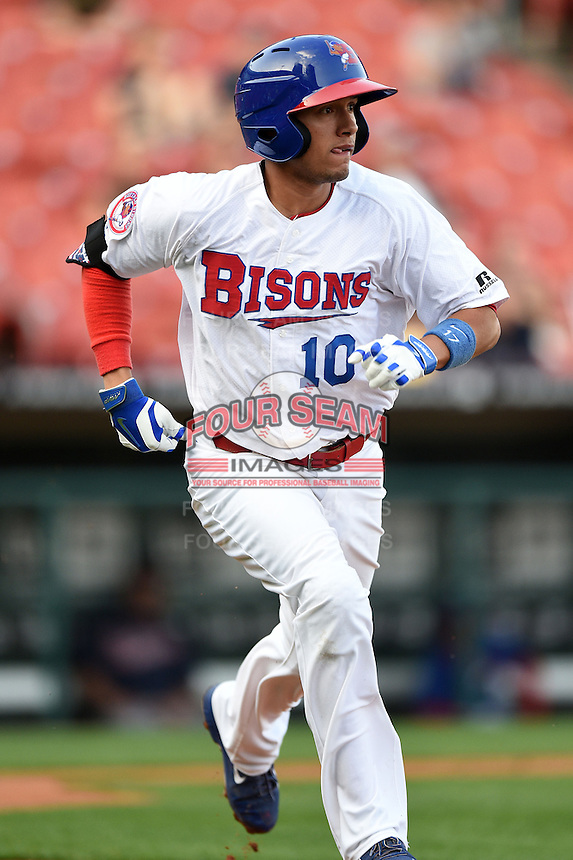 Buffalo Bisons second baseman Ryan Goins (10) runs to first during a game against the Gwinnett Braves on May 13, 2014 at Coca-Cola Field in Buffalo, New  York.  Gwinnett defeated Buffalo 3-2.  (Mike Janes/Four Seam Images)