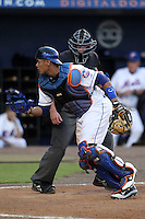 St. Lucie Mets catcher Francisco Pena #11 looks for a passed ball in front of home plate umpire Brian Fields during a game against the Charlotte Stone Crabs at Digital Domain Ballpark on June 20, 2011 in Port St Lucie, Florida.  St. Lucie defeated Charlotte 3-2 in 11 innings.  (Mike Janes/Four Seam Images)
