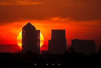 PRESS ASSOCIATION Photo. Picture date: Friday May 06, 2016. The early morning sun rises behind the Canary Wharf skyline, Tower Hamlets, East London.  Photo credit should read: Rick Findler/PA Wire