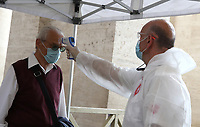 A man undergoes body temperature scanning while going through security to access St. Peter's Square and Basilica on May 18, 2020 at the Vatican in the day of the reopening of St. Peter's Basilica. Italy is slowly lifting sanitary restrictions after a two-month coronavirus lockdown.<br /> UPDATE IMAGES PRESS/Isabella Bonotto<br /> <br /> STRICTLY ONLY FOR EDITORIAL USE