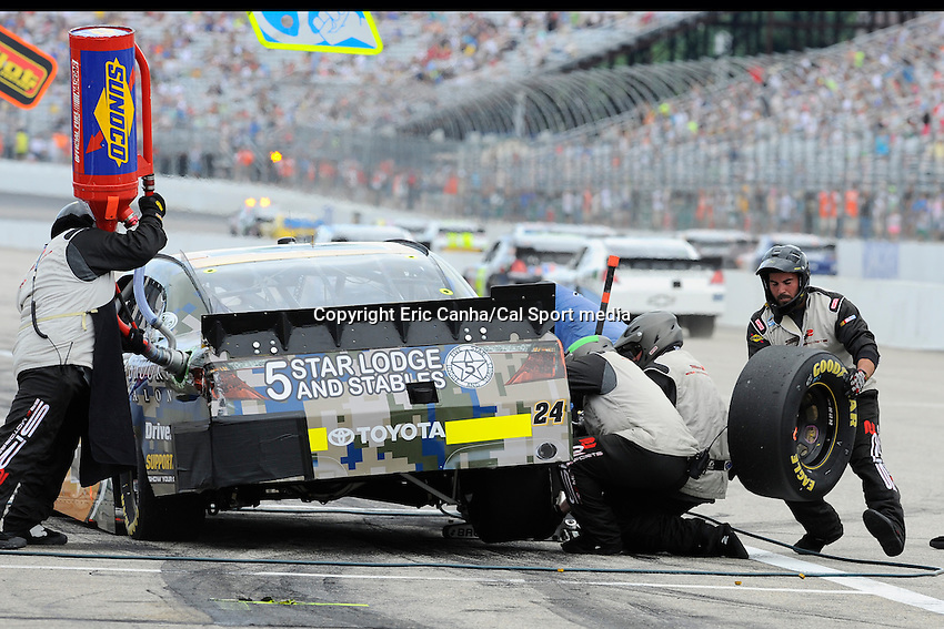 """July 13, 2013 - Loudon, New Hampshire U.S. - Nationwide Series driver Brett Butler (24) makes a pit stop while racing in the NASCAR Nationwide Series CNBC Prime's """"The Profit"""" 200 race being held at the New Hampshire Motor Speedway in Loudon, New Hampshire.   Eric Canha/CSM"""