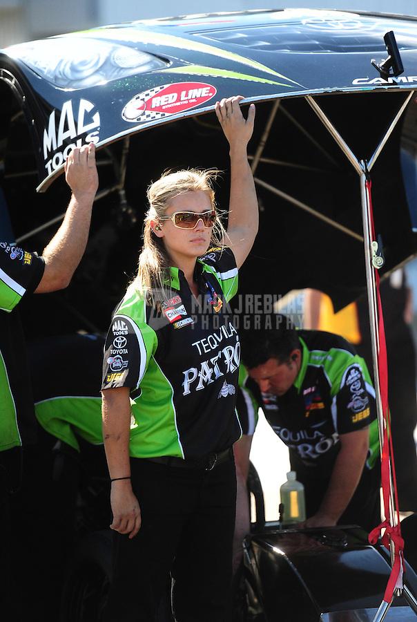 Sept. 24, 2011; Ennis, TX, USA: NHRA crew members for funny car driver Alexis DeJoria during qualifying for the Fall Nationals at the Texas Motorplex. Mandatory Credit: Mark J. Rebilas-