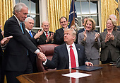 United States President Donald J. Trump shakes hands with US Senator Ed Markey (Democrat of Massachusetts), a sponsor of the bill, after signing the bipartisan Interdict Act, a bill to stop the flow of opioids into the United States in the Oval Office of the White House in Washington, DC on Wednesday, January 10, 2018.  The Interdict Act will provide Customs and Border Protection agents with the latest screening technology devices used to secure our border from illicit materials, specifically fentanyl, a powerful opioid that is destroying lives across the country. <br /> Credit: Ron Sachs / Pool via CNP