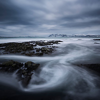 Stormy winter sky over rocky coastline of Austvågøy, Lofoten Islands, Norway