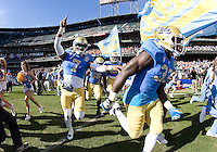 UCLA players run on the field before the game during Kraft Bowl against Illinois at AT&T Park in San Francisco, California on December 31st, 2011.   Illinois defeated UCLA, 20-14.