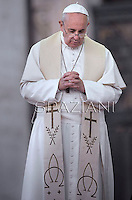 Pope Francis prays in front of Our Lady of Fatima in St. Peter's square at the Vatican on October 12, 2013