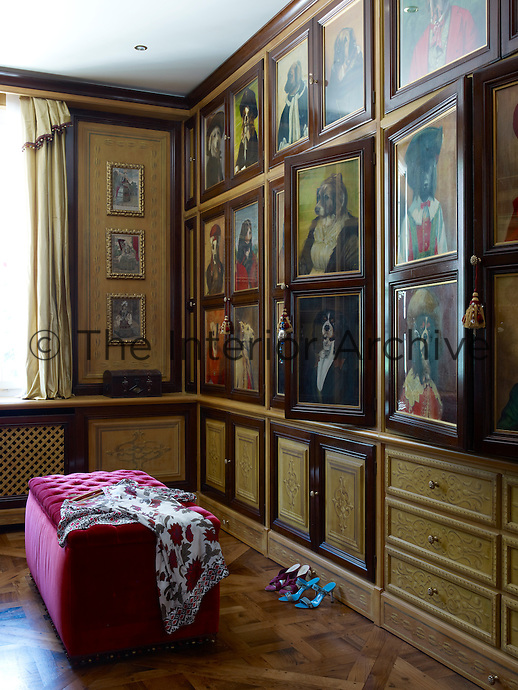 The dressing room is decorated in light-hearted fashion with the doors of the built-in cupboards covered with a series of oil portraits of dogs dressed as gentlemen