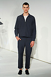 Model poses in an outfit from the Krammer & Stoudt Spring Summer 2018 collection by Michael Rubin, for New York Mens Day at Dune Studios on July 10, 2017; duing New York Fashion Week: Mens Spring Summer 2018.
