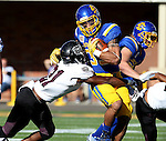BROOKINGS, SD - NOVEMBER 5:  Isaac Wallace #35 from South Dakota State is wrapped up by Cameron Price #21 form Missouri State in the first half Saturday afternoon at Dana J. Dykhouse Stadium in Brookings. (Photo by Dave Eggen/Inertia)