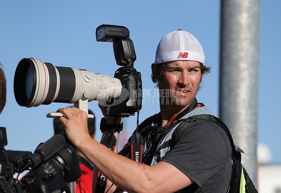 Mar. 1, 2013; Avondale, AZ, USA; Los Angeles Angels pitcher C.J. Wilson works as a member of the media during NASCAR Sprint Cup Series qualifying for the Subway Fresh Fit 500 at Phoenix International Raceway. Mandatory Credit: Mark J. Rebilas-